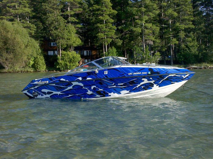 Blue Camouflage Total Covering On Little Boat Boat