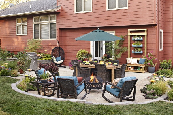 Whip a basic concrete pad into shape for summer entertaining. Add curves to the edges, and create zones for dining, lounging, and gardening.