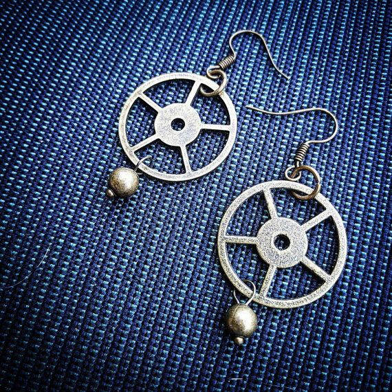 This pair of earrings were made with matching brass flywheels and beads
