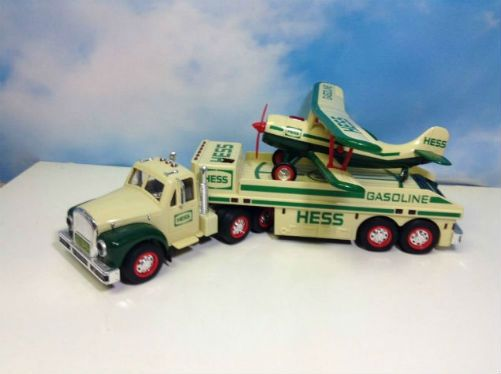 Vintage 2002 Hess Toy Truck and Airplane. The 2002 is a change up with two toys in one. The 2002 Hess Toy Truck and Airplane is classic and different. No revisions here. Lots of chrome on the cab of the eighteen wheeler flatbed tractor-trailer that shines and the curved green fenders and rounded headlights reflect an older Mack truck giving it character.