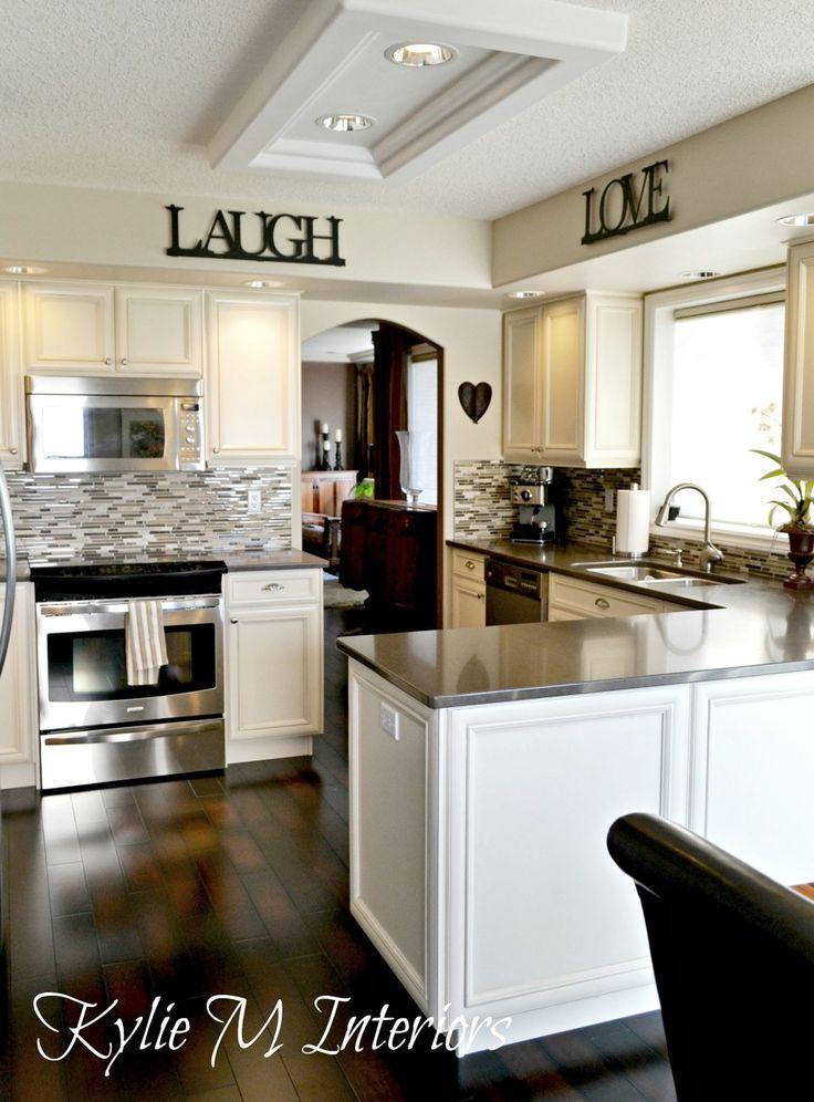 Oak Kitchen Update And Remodel With Cream Painted Cabinets Quartz Countertops Dark Wood Floor