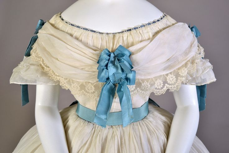 Sheer white cotton dress with blue satin sash. French, early 1860s, KSUM 1983.1.2071a-h