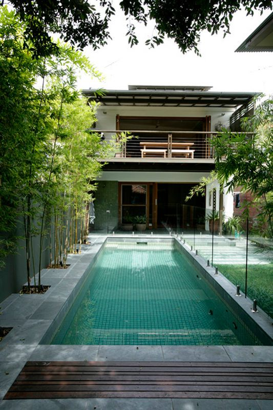LOVE this backyard. How the different materials (bamboo would be good for our Texas backyard) break up the space and make it seem larger, yet cozy.