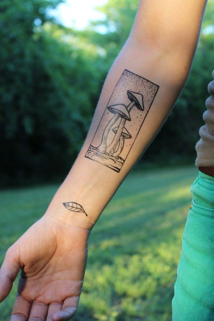 Super earthy temporary tattoo ~ Three tall growing mushrooms framed in a rectangle. Love fungi tattoos!