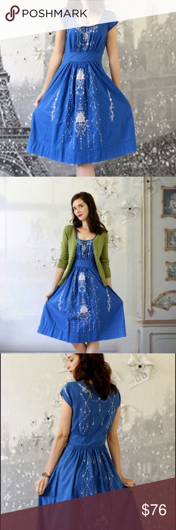"""ANTHROPOLOGIELIL HARISSA EMBROIDERED DRESS Super cute. Dress Anthro brand Lil.  This brilliant blue with the white floral embroidery. Everything about this dress is perfect, and I especially love the attention to detail on the back as well as the front. Side hidden zipper, capped Sleeves. Fully lined with the same beautiful blue that's on the outside. 100% cotton machine wash. Banded waist for added shape definition. Measurements taken flat bust 17"""" waist 13"""" length 40"""" Anthropologie Dresses…"""