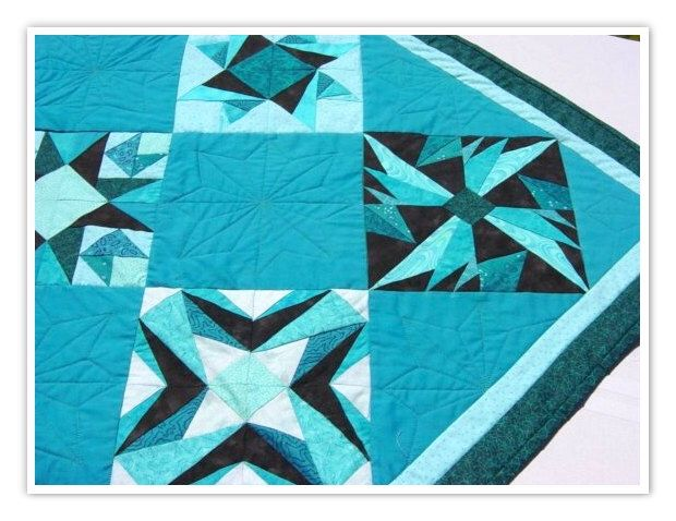 Lap Quilt, Wall Hanging quilt, Teal paper piece quilt 39x50, gorgeous teals and black, home decor, teal quilt, teal quilted wall hanging by MyCraftBooth on Etsy https://www.etsy.com/listing/42359935/lap-quilt-wall-hanging-quilt-teal-paper