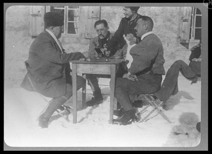 (1924; Chamonix, France) Three members of the Swedish curling team taking a break to have a drink.