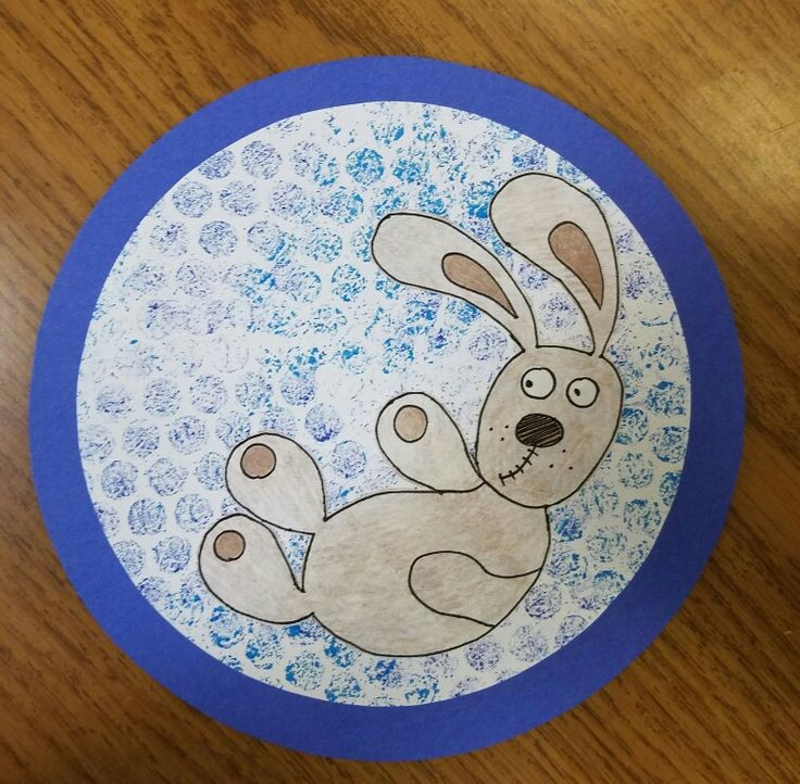 Mo Willems Knuffle Bunny (photo only) two circles represent washing machine. Color with washable markers onto bubble wrap then stamp to create bubbly background. Hand drawn bunny added to the top and colored.