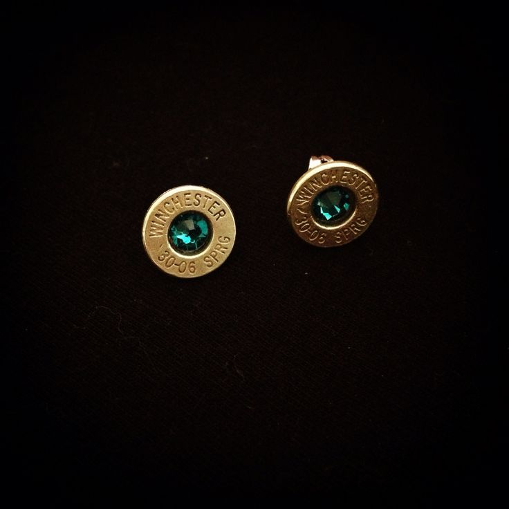 Bullet Stud Earrings - Custom earrings handmade from recycled ammunition by Center Fire Jewellery. Rifle Caliber - Brass Winchester 30-06 Springfield with teal (blue zircon) Swarovski centers. Check out our website for more!! centerfirejeweller.wix.com/bullets Earrings, necklaces, rings, cuff links and more. Variety of calibers and colours to choose from.