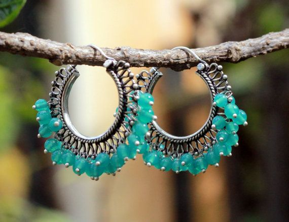 Oxidized sterling silver hoop earrings with light green/blue pearls