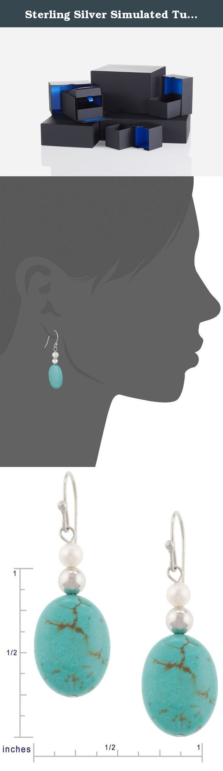 Sterling Silver Simulated Turquoise Oval Bead and White Freshwater Cultured Pearl Drop Earrings. Capture the true blue beauty of turquoise when donning the Sterling Silver Turquoise Oval Bead and White Pearl Drop Earrings. Hanging from each fishhook backing is a beautiful oval-shaped turquoise bead that shows off its brilliant blue hue and organic look. The beads each contain dark lines, or natural definitions that create a one-of-a-kind look for each earring. Accenting each turquoise…