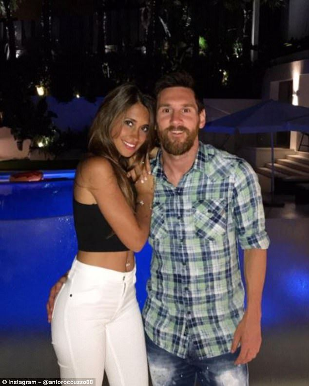 Lionel Messi poses for a photo with his wife-to-be Antonella Roccuzzo in Spain this week