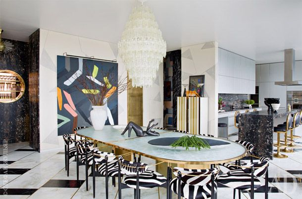 A fantastic dining room with loads of marble and gorgeous zebra upholstered chairs // Kelly Wearstler