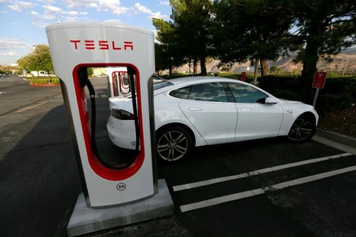 Tesla Motors Inc (TSLA.O) crowned itself the maker of the world's fastest production car on Tuesday, saying a new version of its Model S all-electric sedan can accelerate from 0-60 miles per hour in just 2-1/2 seconds.