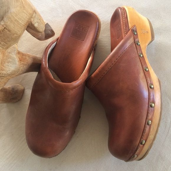 Frye leather clogs Frye makes good quality items.  These are vintage clogs with character. Small nicks on wooden heel, but that makes them interesting.  Leather in great condition. Inside the shoes is clean. Frye Shoes Mules & Clogs