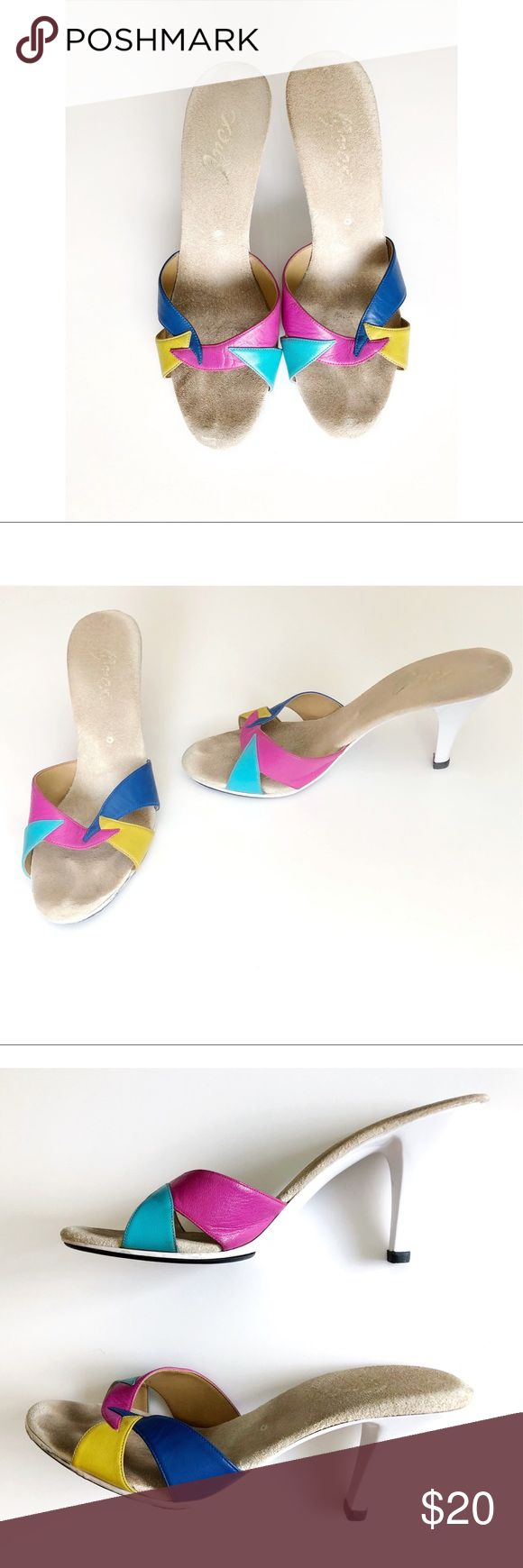 Vintage Onex Multicolored Leather and Suede Heels Fabulous retro tropical style Onex Heels. The leather is pink, teal, Royal Blue and Yellow with a Suede insole. The base of the heel is a white and black plastic. Shoe is in great vintage condition with light wear and a small crack towards the bottom of the heel. See pictures. Size and Insole measurements coming tonight. Please contact me with any questions. Onex Shoes Heels