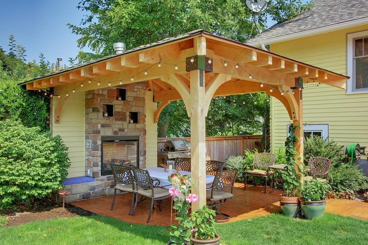Patio Shade Structures Landscape Mediterranean with Flagstone Traditional Standard Height Outdoor Dining Sets