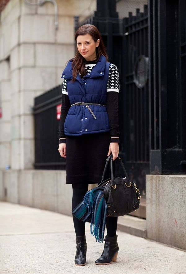 such a smart looking outfit - belted outerwear vest, short-sleeved patterned sweater, black long-sleeve, pencil skirt, tights, booties