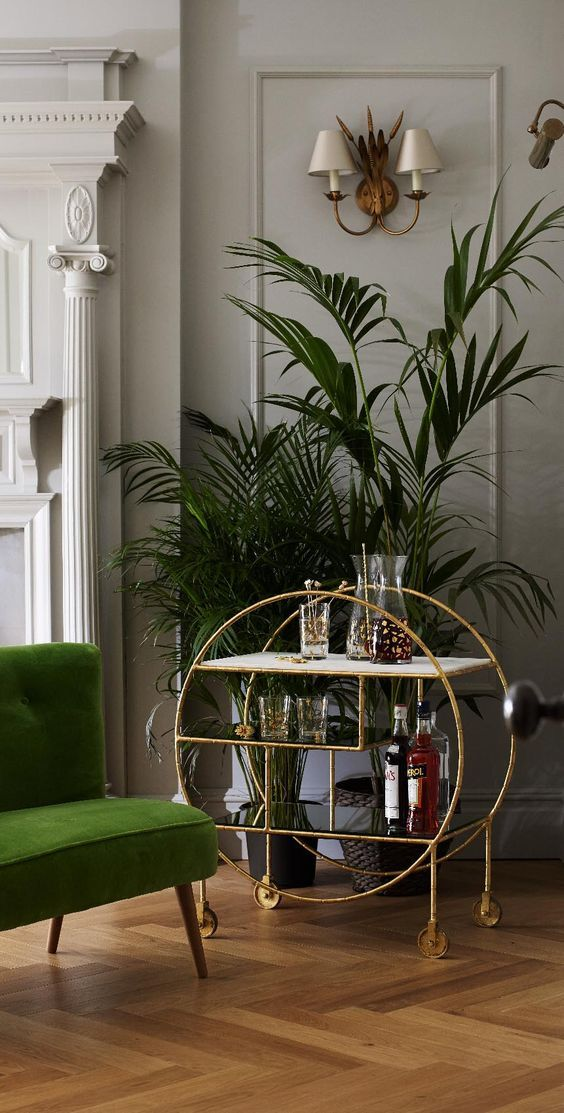 With a mixture of marble and burnished mirrored shelves and castor wheels, this rough luxe drinks trolley will allow you to play host to your guests in style. Complete the setting with mixed metallic, brass and wooden finishes.: