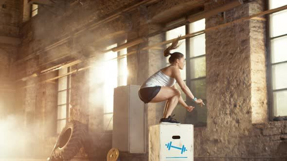 Fit Athletic Woman Does Box Jumps in the Deserted Factory Gym. Intense Exercise