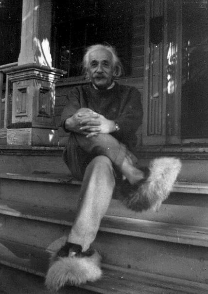 Albert Einstein wearing his favourite slippers.