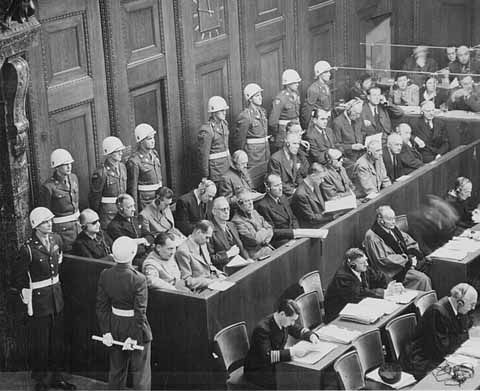 The defendants at Nuremberg. Front row, from left to right: Hermann Göring, Rudolf Hess, Joachim von Ribbentrop, Wilhelm Keitel, Ernst Kaltenbrunner, Alfred Rosenberg, Hans Frank, Wilhelm Frick, Julius Streicher, Walther Funk, Hjalmar Schacht. Back row from left to right: Karl Dönitz, Erich Raeder, Baldur von Schirach, Fritz Sauckel, Alfred Jodl, Franz von Papen, Arthur Seyss-Inquart, Albert Speer, Konstantin van Neurath, Hans Fritzsche.