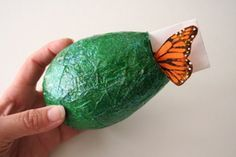 make a butterfly chrysallis with balloon, tissue paper and mod podge.  I did this last year and it was beautiful.