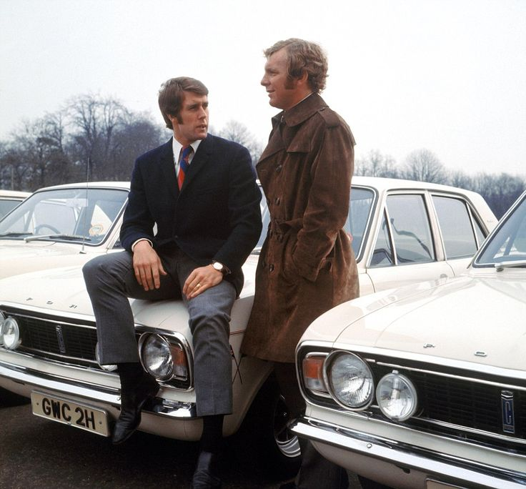 West Ham United and England teammates Geoff Hurst and Bobby Moore admire the ranks of Ford Cortinas in this 1970 picture