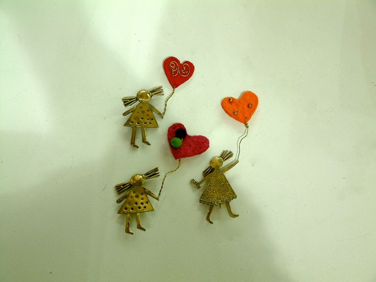 Love is in the air. Broaches. Bronze, papie mache, felt wool.