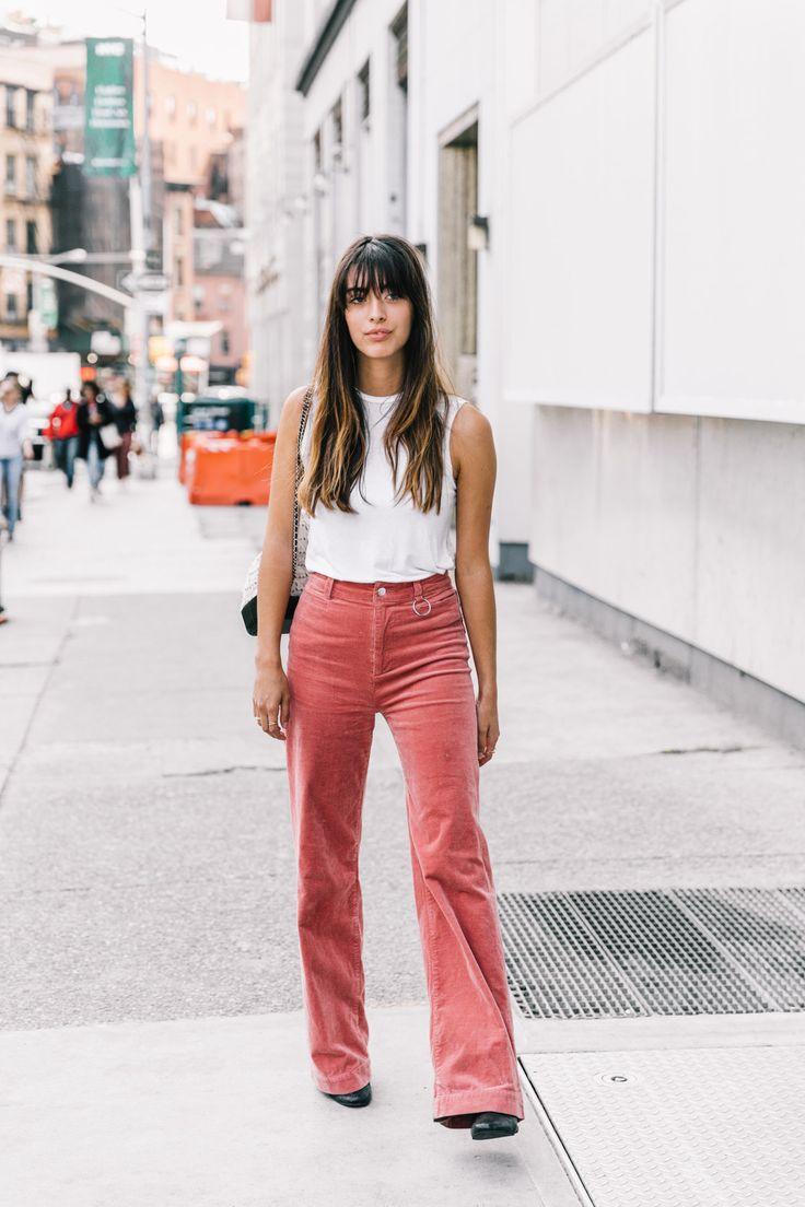 Pink corduroy trousers white tank top