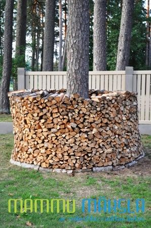 Firewood doesn't have to be stacked in traditional way. This round stack becomes also an exterior object.