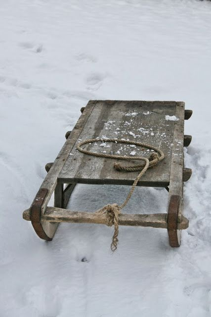 We had a sledge very like this, but it never snowed in Horsham. Richard pulled me round the front garden one bright summer day and we wrecked the lawn....