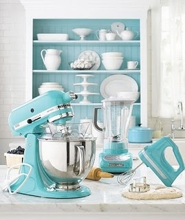 Kitchen Utensils - I want these in this color to go with the black and white kitchen of my dreams....(Wow! I'm not alone!)