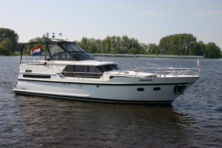 "Houseboat ""Valk-Content 1200"" for 2 persons, cruising the beautiful Frisian Lake District in Holland."
