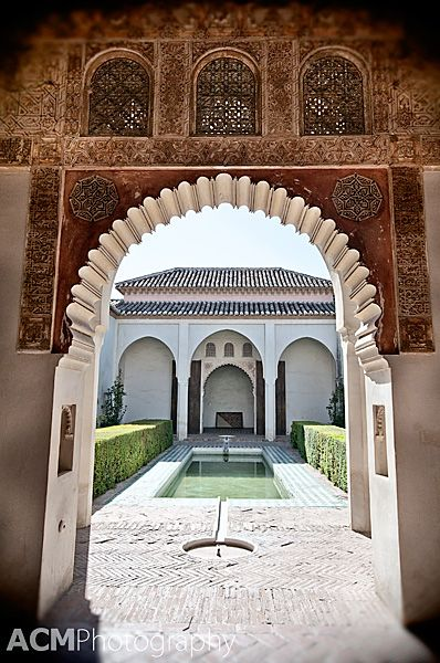 The Detailed archway of the Cuartos de Granada at the Alcazaba of Malaga, Spain | CheeseWeb
