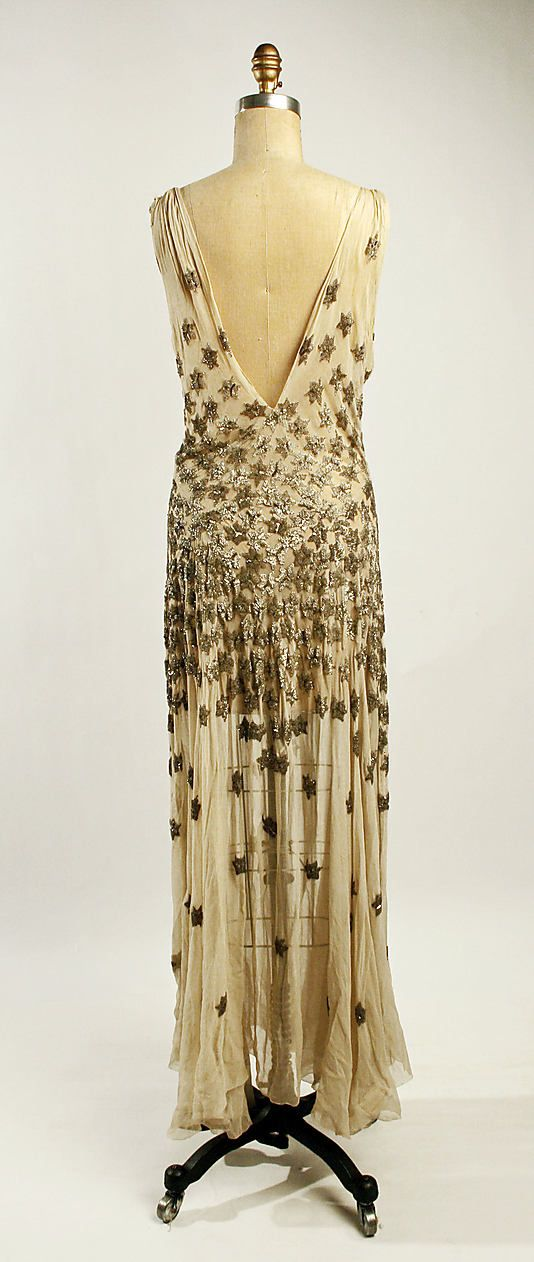 Beautiful dress from 1930-31. Designed by Madeleine Vionnet. I love the low back and the stars.