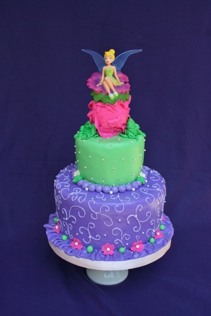 Love this Tinkerbell Cake...like the lighter designs on the purple layer...