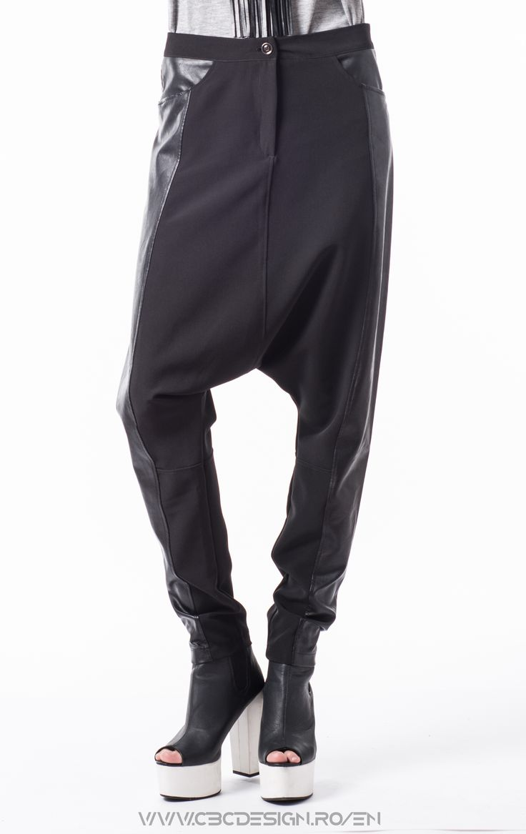 Description: Loose fitted low-crotch pants, with pockets and side leather insertions.extremely comfy thanks to their loose form, the can be worn with Air Max shoes, a simple top and a baseball cap fot a hip-hop look. Or with platforms and a shiny top for a glam night. Because of the matte suiting fabric, the can be transformet into an office look, paired with stilletos and a crisp white shirt.