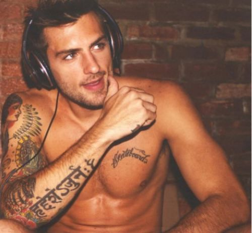 MMMM....Yes please!!  Nothing hotter than a guy with tattoos, enjoying music!!