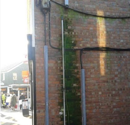Penetrating damp caused by a damaged down pipe
