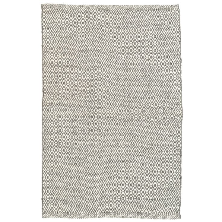 Test drive this rug in your space.Order a swatch by adding it to your cart.This grey-and-white, diamond patterned indoor/outdoor rug, made out of recycled materials, is a contemporary décor dream. Mix and match with our Gradation Ticking indoor/outdoor rug.