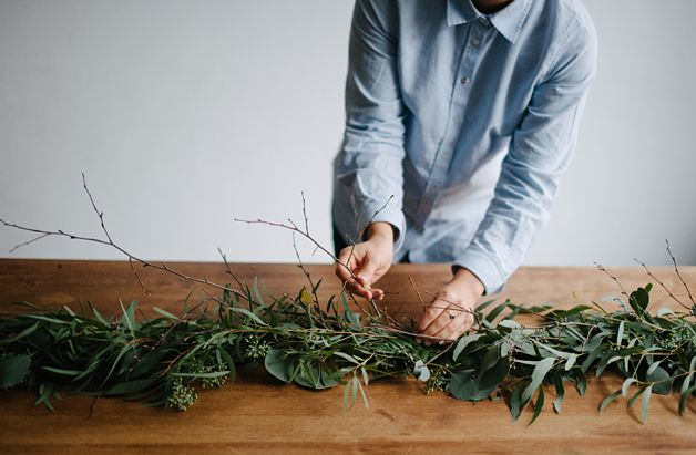 A diy table runner swag made from rustic greenery and