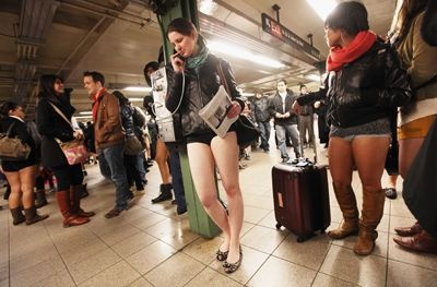 NYC. Jan 9, 2012. No Pants Subway Ride participants gather in the Union Square subway station during the annual ride in New York. Everywhere, the goal was to get on the subway train dressed in normal winter clothes (without pants) and keep a straight face.