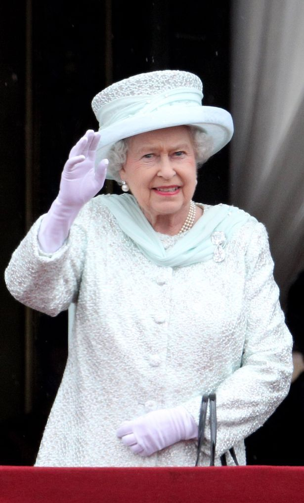 Brave face: The Queen waves but was missing her husband