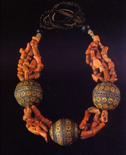 Woman's necklace from the Anti-Atlas, Morocco. |  Coral, enameled silver, and glass beads | From the Colette and Jean-Pierre Ghysels Collection, and this photo is included in the publication 'The Splendour of Ethnic Jewelry'