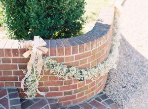 Baby's breath garland with a cream colored bow.  Photo by Adam Barnes.