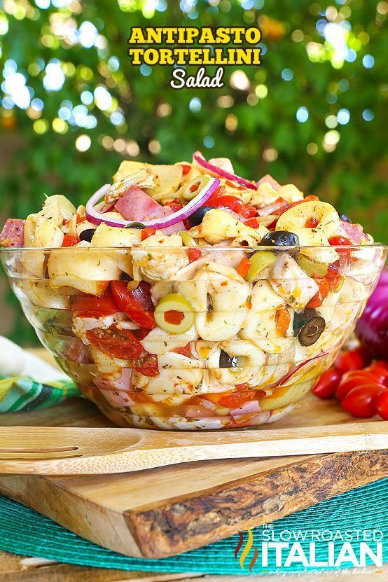 My latest summer obsession is a fusion of your favorite antipasto together with a pasta salad that is tossed with an amazing homemade zippy Italian dressing that will make your tastebuds sing. This easy recipe for Antipasto Tortellini Salad will become yo