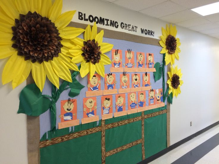 This is a bulletin board idea from the flower wreath idea I pinned, sunflower images and the large paper flowers I also pinned.
