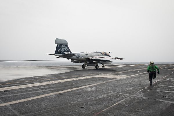 INDIAN OCEAN (June 8, 2013) An EA-6B Prowler assigned to the Gray Wolves of Electronic Attack Squadron (VAQ) 142 lands on the flight deck of the aircraft carrier USS Nimitz (CVN 68). Nimitz Strike Group is deployed to the U.S. 7th Fleet area of responsibility conducting maritime security operations and theater security cooperation efforts. (U.S. Navy photo by Mass Communication Specialist 3rd Class Raul Moreno Jr./Released)