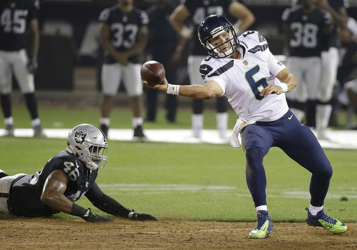 "Seattle Seahawks quarterback Austin Davis (6) passes in front of Oakland Raiders linebacker LaTroy Lewis (46) during the second half of an NFL preseason football game in Oakland, Calif., Thursday, Aug. 31, 2017. (AP Photo/Eric Risberg) ""... some of the stats are startling, and standing out most is that Davis had more than double the passer rating of Boykin — 115.9 to Boykin's 66.2."""